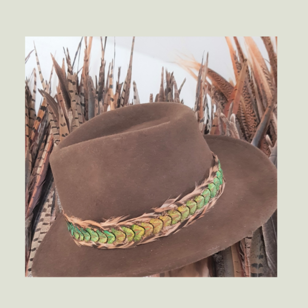 peacockgold hatband in workshop